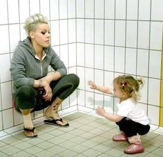 "P!nk giving Willow that :Mommy Look"" and Willow throwin a karate move on mama... lol, cute pic of my two favorite women"