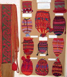 A wide tapestry crocheted sash, a narrow woven sash,   and tapestry crocheted cuffs and bags in the Korsnäs Museum.
