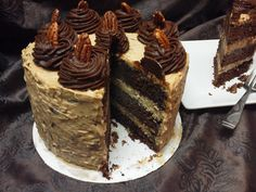 GERMAN CHOCOLATE CAKE This traditional dessert is made with three layers of German Chocolate Cake separated by homemade thick coconut and pecan filling.  Decorated with coconut and lightly toasted pecan buttercream and fudge rosettes.  Will serve 12 to 14 and weighs over 5 pounds and 2 ounces.  FREE 2 DAY SHIPPING