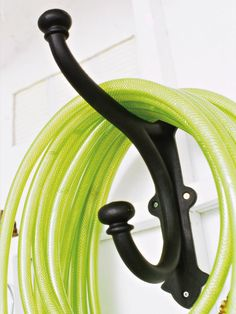 Help for Hoses - If you've ever tripped on a coiled-up hose, you know what a pain they can be. Make your garden hose easy to find and get it out from underfoot by wrapping it on a large hook.