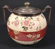 Lot: 369: Doulton Burslem globular biscuit barrel with silve, Lot Number: 0369, Starting Bid: £10, Auctioneer: Eastbourne Auctions, Auction: Fine Art, Antiques and Collectables, Date: March 21st, 2008 CET