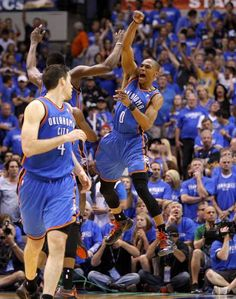 Oklahoma City's Russell Westbrook (0) celebrates beside James Harden and Nick Collison during Game 4 of the first round in the NBA playoffs between the Oklahoma City Thunder and the Dallas Mavericks at American Airlines Center in Dallas, Saturday, May 5, 2012. Oklahoma City won 103-97.