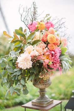Wedding Flower Arrangements - Get ready for an explosion of pretty m'dears, because this blend of rustic goodness, color, charm and romance is _exactly_ that. Isari Flower Studio is blowing my mind with their insanely beautiful.