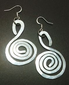 100% Handmade hammered sliver tone swirl earrings. Simple and exquisite. Approx. 2.5 inches in length. Hypoallergenic posts.