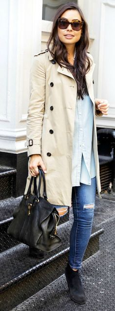 Kat Tanita + gorgeous cream trench + Burberry + worn casually + pair of distressed jeans + oversized blouse + pair of wide-brimmed shades + leather bag + capture this style.   Trench: Burberry, Jeans: Shopbop, Boots: Fraye.