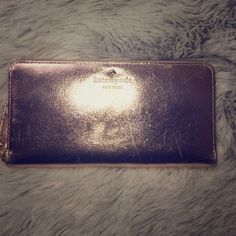 Kate Spade Rose Gold Wallet Brand new with minor scratches to this delicate beauty! Unique color and style! Rose gold color! Multi functional pockets. Zip-around closure. Inside 12 credit card slots, 1 zipper pocket and 2 full length bill compartments 1 slide pocket at the back Gold printed Kate Spade New York signature and spade stud . kate spade Bags Wallets