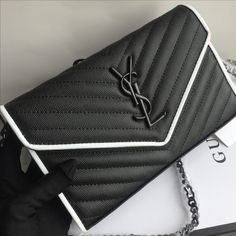 9aa2a789f454 Ysl Saint Laurent woman slp chain flap bag caviar leather black with white  trim
