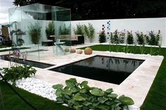 Modern Garden With Glass Cube And Ponds : Elegant And Airy Modern Garden Designs