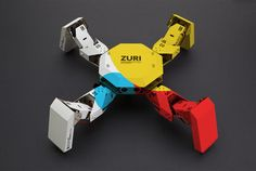 ZURI 01 Paperbot System is a programmable, modular robotics platform created by Germany company Zoobotics that users build with cardboard and paper. The smartphone-controlled DIY robot is currently. Diy Robot, Robot Kits, Arte Robot, Paper Robot, Cardboard Robot, Programmable Robot, Cool Robots, Robot Design, Futuristic Design
