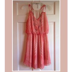 ✨ Beautiful dress Beautiful dress in fresh swirly stripe pattern of orange/salmon and white. Cinched waist, double spaghetti straps for great lines. Excellent condition Poetry Dresses