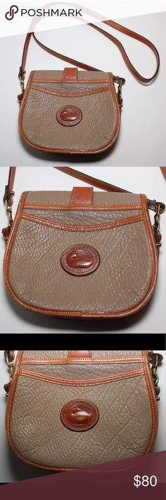 Dooney & Bourke Leather Vintage Crossbody Bag Super cute top quality vintage 90's Authentic Dooney&Bourke Crossbody style. Tan/ dark beige with brown/rich tan accents/strap, brass accent hardware, long strap, secure and cute buckle through closure, signature emblem. Please review the pics carefully, all ware is photographed Dooney & Bourke Bags Crossbody Bags
