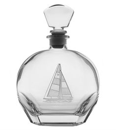 Entertain in elegant style on the coast (or on your yacht!) with our 23 oz. nautical double-etched sailboat design whiskey decanter. Truly a statement piece for the captain!