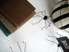 spiders! These little cuties are made of wire and hot glue, and are just about as simple as anything I have ever shared with you.
