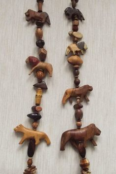 Designer very long wooden OOAK necklace with vintage wood lions and nut beads