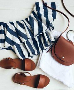For spring break, pair a white and navy striped off-the-shoulder top with leather accessories. Let Daily Dress Me help you find the perfect outfit for whatever the weather! dailydressme.com/