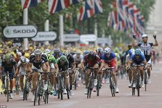 Stage 3 Finish: A teammate, rear right, celebrates as Germany's sprinter Marcel Kittel, front left...