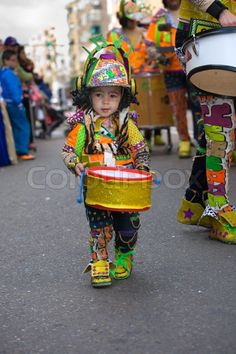 BADAJOZ, SPAIN, MARCH 4: Little boy plays drum at Carnival parade of comparsas at Badajoz City, on March 4, 2014. This is one of the best carnivals in Spain, renown by all the national news media and especially highlighting massive participation of people. | Stock Photo | Colourbox on Colourbox