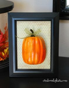 framed pumpkin. so easy and so cute for fall decor! i'd spraypaint the frame brown or something other than black to go with our other decor though.