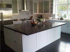 More concrete countertops.....can't get enough of them!  And my ongoing theme of white kitchen cabinets!