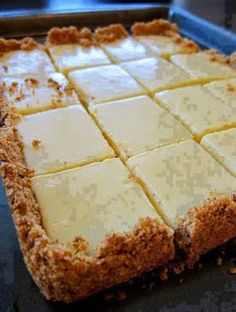 FOR THE CRUST 4 tablespoons butter, melted and cooled, plus more for pan 1-1/2 cup graham cracker crumbs 1/4 cup sugar FOR THE FILLING 2 large egg yolks 1 can (14 ounces) sweetened condensed milk 1/2 cup fresh lemon juice (3 lemons) DIRECTIONS: *Preheat oven to 350F / 180C degrees. *Brush a square b…