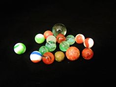 A fun varied assortment of marbles, plus one large clear glass shooter. $9.99