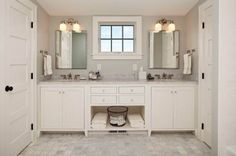 The master bathroom, with its symmetrical double vanity, is day lit and ventilated with an awning window.
