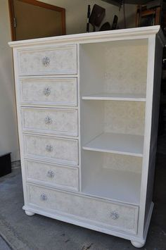 how to use textured wallpaper on furniture, painted furniture, The lady who bought this has it in her dining room and uses it to hold all her and her little girls craft and art supplies What a fun way to hide stuff and still make your room look elegant