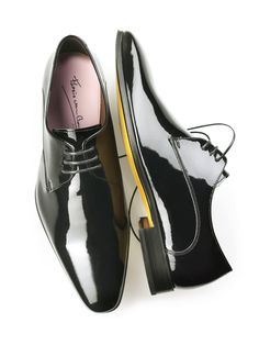 703bb78011bb8 Black patent leather dress shoes are a perfect staple piece in any mans  wardrobe. These shoes pair very nicely with a tailored suit no matter what  color or ...