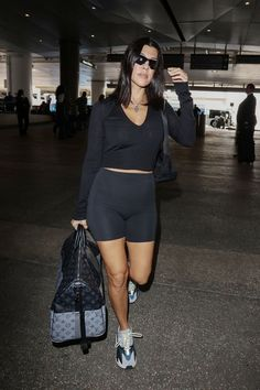Kourtney Kardashian wearing Louis Vuitton Luggage and Adidas Sneakers Kourtney Kardashian Workout, Kardashian Photos, Kardashian Style, Airport Attire, Gucci Leather Belt, Louis Vuitton Luggage, Cycling Shorts, Sporty Style, Sport