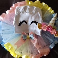 Kit contém 1 body ou blusa 1 saia de tule 1 tiara