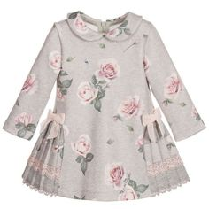 Girls pretty pink rose printed, long-sleeved grey dress by Lapin House. Made with super soft jersey, fastening with a concealed zip at the back. It has pretty pleating from the hips and round the back, trimmed with grey and pink lace. Frocks For Girls, Kids Frocks, Little Dresses, Little Girl Dresses, Dresses Dresses, Pleated Dresses, Sleeve Dresses, Fashion Dresses, Girls Dresses