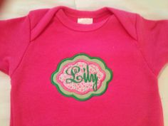 Pink or White Monogramed Baby Girl Onesie with Monogram Frame in Pink and Green Fabric  0-18 months by PurttyStitches on Etsy https://www.etsy.com/listing/195467210/pink-or-white-monogramed-baby-girl