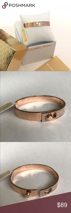 """MICHAEL KORS Astor Rose Gold Pavé Bangle Bracelet Guaranteed Authentic! Micharl Kors Astor pavé rose gold bracelet. Mix metal bangle and embellished crystals in rose gold tone. Engraved Michael Kors logo on the exterior plain metal side as well as in the interior part of the bracelet. Fold over clasp. Measurement: 2.25"""" diameter. Blue heart box not included, only MK gold box included with bracelet listing. Item will be videotaped prior to shipping to ensure proof of condition. Michael Kors…"""
