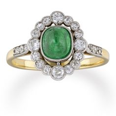 An oval emerald and diamond cluster ring - Bentley & Skinner