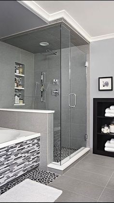I like the contrasting pebble tile in the shower and at the base of the tub.