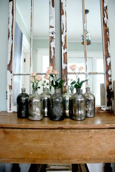 Simple bottles can be painted with mirror glass paint and a spritz of vinegar water.