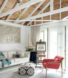 Vaulted ceiling. Painted white beams. Beach style.