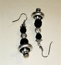 MJ-128; A Pair of Eye Catching Earrings- Silver Beads and Findings with Faceted Black Glass Beads Silver Beads, Silver Earrings, Drop Earrings, Craft Items, Black Glass, Pearl White, Mj, Ear Piercings, Glass Beads