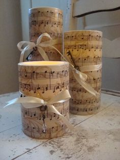 Sheet Music Candles …… Mod Podge old sheet music ( or print out some ) to Candles. Add ribbon, raffia , charms ( your choices ) for a finishing touch.