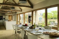 0231a - open plan dining in this beautiful cotswold country escape http://www.thecountrycastlecompany.co.uk/venues/0231A-Chic-Bolthole-Barn-Conversion/