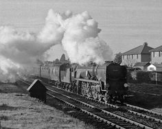 Bournemouth's 'Battle of Britain' Pacific 34085 accelerates through Ashley with an eastbound express for London.  Hampshire, UK. Negative scan.
