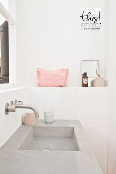 Soft pink accessories in minimal bathroom