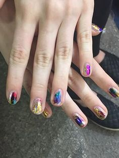 Milan fashion week has been full of major hair and makeup moments, but with a rainbow of bright shadows, cans of colorful hair spray, and spools of metallic nail foils, Giamba takes the cake. Here are four different ways...