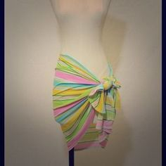 I just added this to my closet on Poshmark: Multi Colored Striped Swimsuit Cover Up Wrap. Price: $40 Size: OS