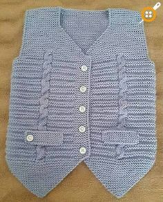 It's a beautiful baby vest.You can get detailed information about this model from the link below. Baby Knitting Patterns, Knitting For Kids, Easy Knitting, Crochet For Kids, Knitting Designs, Crochet Baby, Baby Pullover, Baby Cardigan, Baby Boy Vest