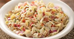 Johnny Carino's Bowtie Festival. Made this for Hubby the other night, delish! Farfalle, garlic, bacon, alfredo sauce, asiago, chicken, red onions, cream!