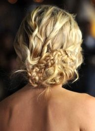 textured messy updo with braid.
