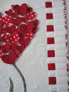 close up, Hearts Wall Hanging by Linda at Sew Grateful Quilts. Feather background fill with an occasional heart.
