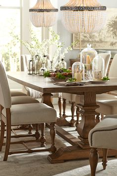 The Havertys Avondale dining collection is rustic and chic with it's vintage oak finish table and natural-colored chair upholstery.