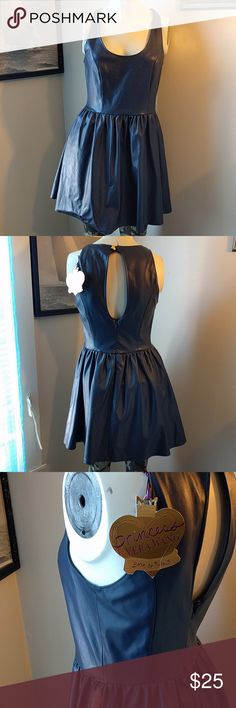 NWT Leather Skater Dress Navy almost purple pleather dress. The bodice to skirt hem could use some reinforcement. Reposh, it came that way.   ? Please bundle and save! LMK if you want to bundle trade!   Looking forward to a healthy and abundant New Year, and I wish you the same ? Vera Wang Dresses Mini